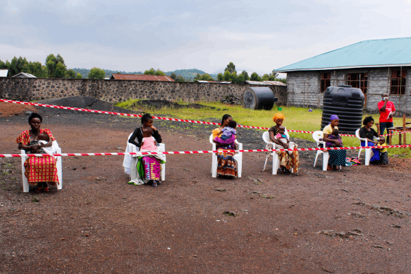 Mothers queueing to have their children vaccinated
